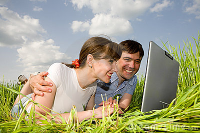 Casual happy couple on a laptop computer