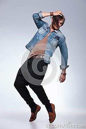 Casual man balancing on his toes
