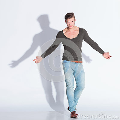 Casual man extends his arms in rage