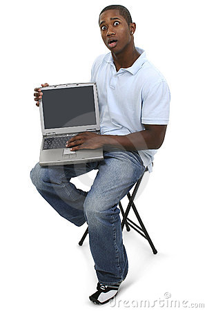 Casual Man with Laptop Computer and Shocked Expression on Face