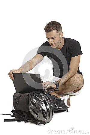 Casual man with laptop and helmet