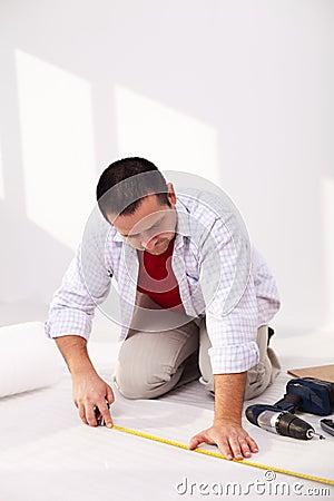 Casual man laying isolation beneath flooring