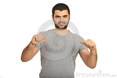 Casual man pointing to his blank tshirt