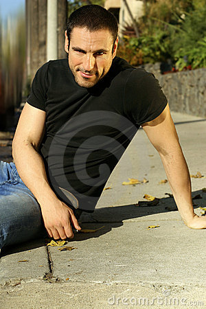 Casual man on sidewalk