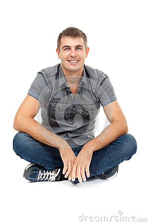 Casual man sitting in lotus position, smiling