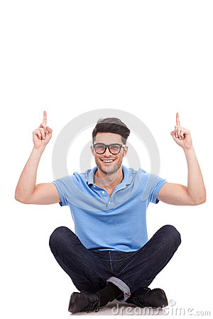 Casual man sitting and pointing up