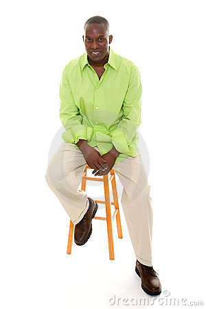 Casual Man Sitting On Stool