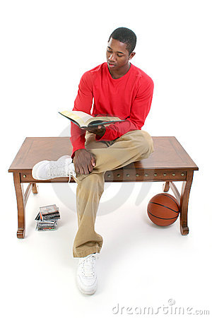 Casual Man Sitting on Table Reading Book