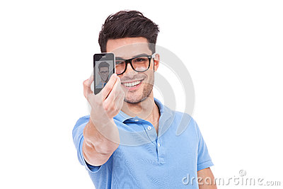 Casual man taking a photo of himself