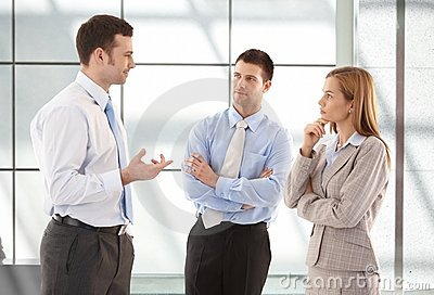 Casual office workers talking in hallway