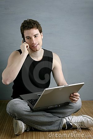 Casual student talking mobile phone laptop sit