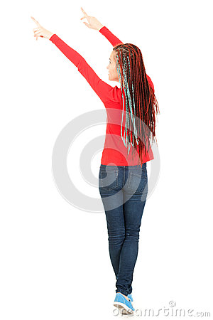 Casual teenage girl in african plaits pointing up