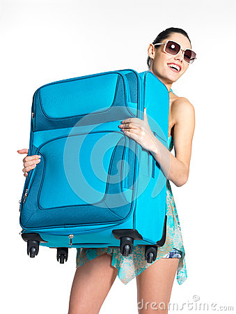 Casual woman holds the heavy travel suitcase