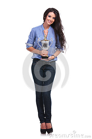 Free Casual Woman Holds Her Trophy And Smiles Royalty Free Stock Image - 34027366