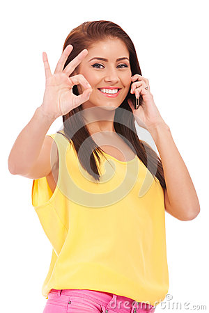 Casual woman with phone and ok gesture