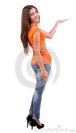 Casual woman pointing to open space