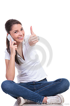 Free Casual Woman Sits & Thumb Up On Phone Royalty Free Stock Photography - 31288867