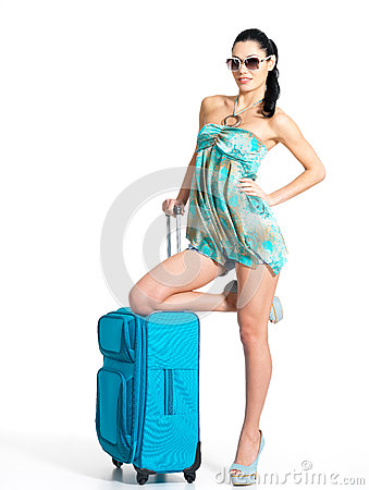 Сasual woman standing with travel suitcase