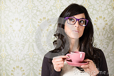 Woman thinking with cofffe cup