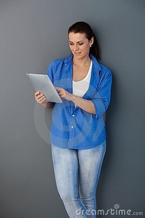 Casual woman with touchscreen computer
