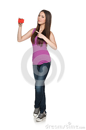 Casual young female showing blank credit card pointing at it