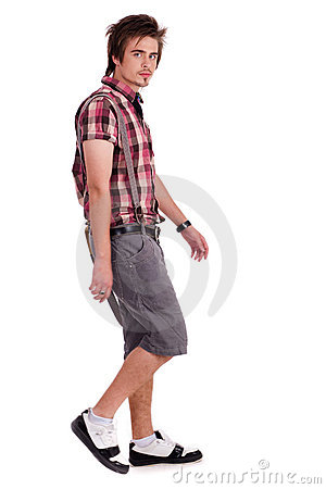 Casual young guy in walking posture