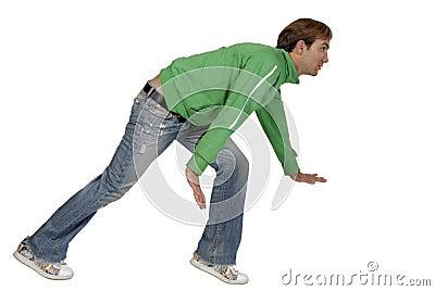 Casual young man crouching