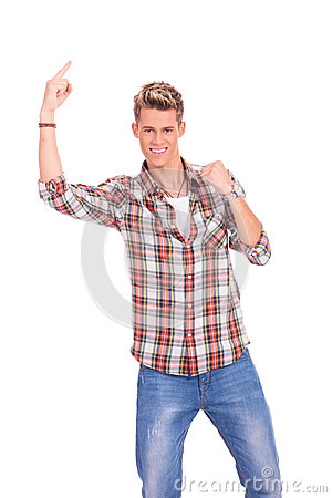 Casual young man pointing up
