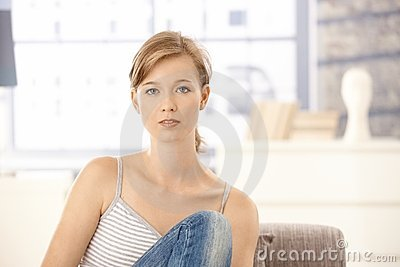 Casual young woman at home