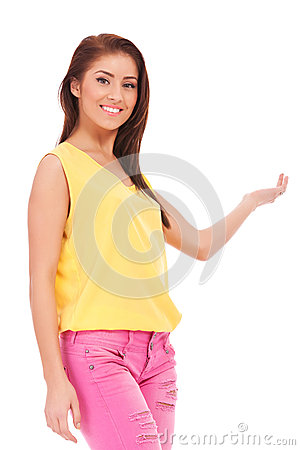 Casual young woman presenting something