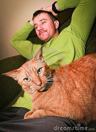Free Cat And Man Relaxing Stock Images - 23195664
