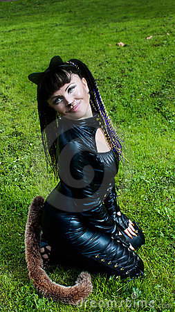 Cat Woman on the grass