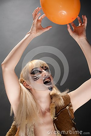 Cat-woman playing with a ball