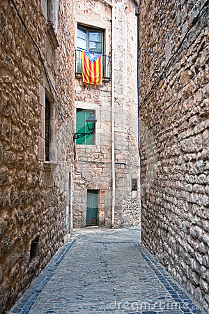 Catalan flags placed on balcony on street in Girona, Spain