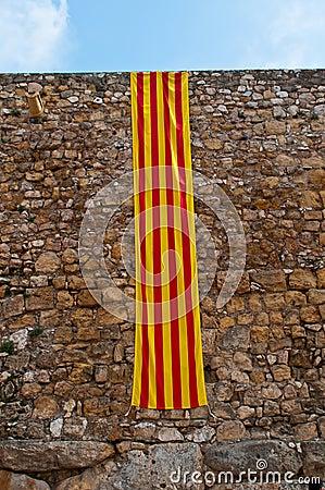 Catalonia flag at ancient wall