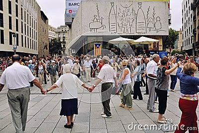 Catalonian people dancing Sardana in Barcelona Editorial Image