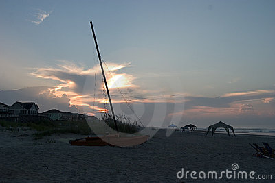 Catamaran on beach, Sunrise