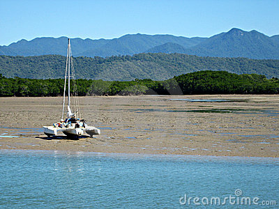 Catamaran on Tidal Mud Flats