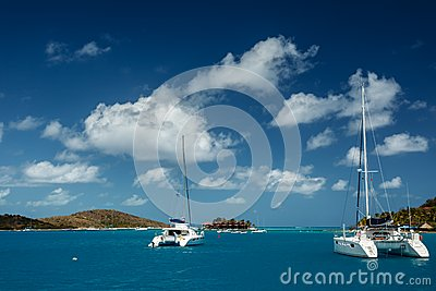 Catamarans in turquoise tropical waters in British Virgin Islands