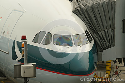 Cathay pacific aircraft near boarding bridge editorial image image 59923970 - Cathay pacific head office ...