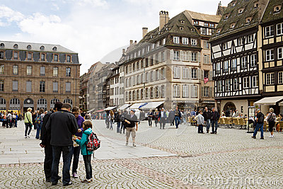 The cathedral square in Strasbourg with tourists Editorial Photo