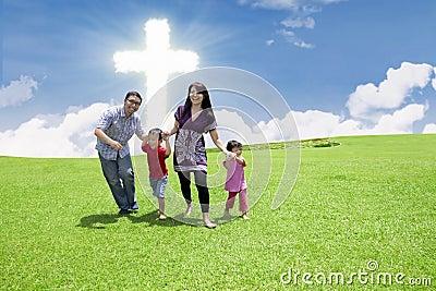 Catholic family at the Cross