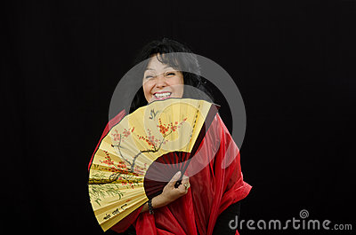 Caucasian actress laughing with a fan