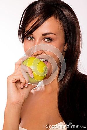 Caucasian beauty eating an apple