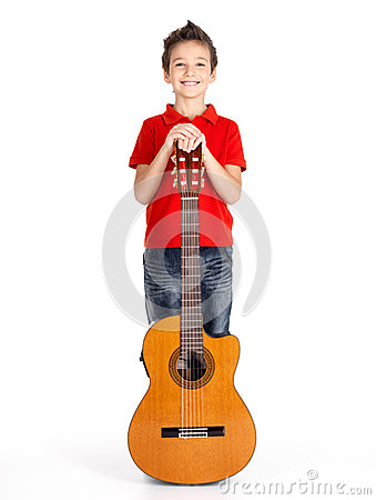 Caucasian boy with acoustic guitar