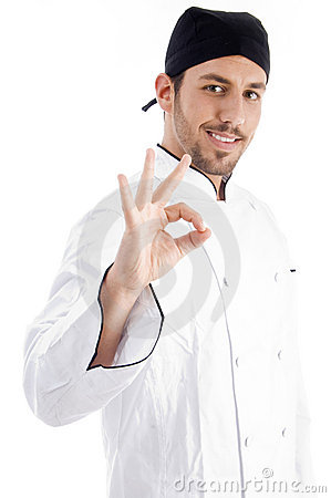 Caucasian chef showing okay hand gesture