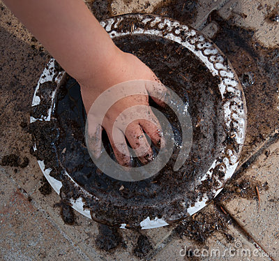 Child making a mud pie