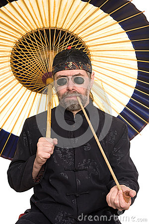 Caucasian in Chinese costume smokes pipe
