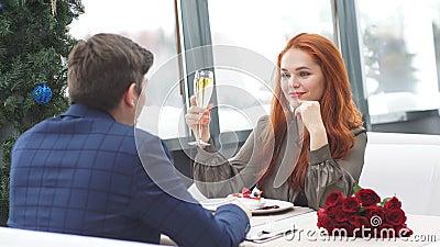 Caucasian couple celebrate their anniversary. Young caucasian couple celebrate their anniversary in rich modern representative restaurant. Anniversary stock video