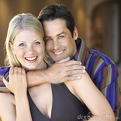 Caucasian couple smiling.